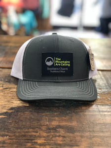 "Southern Charm ""The Mtns Are Calling Leather Patch"" 112 Trucker Hat Charcoal/White Adult"