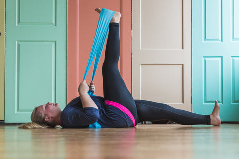 Woman using resistance band for flexablity