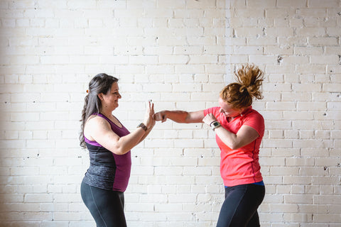 Women shadow boxing with each other