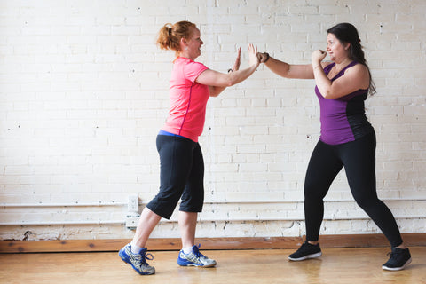 Women partners boxing for fitness
