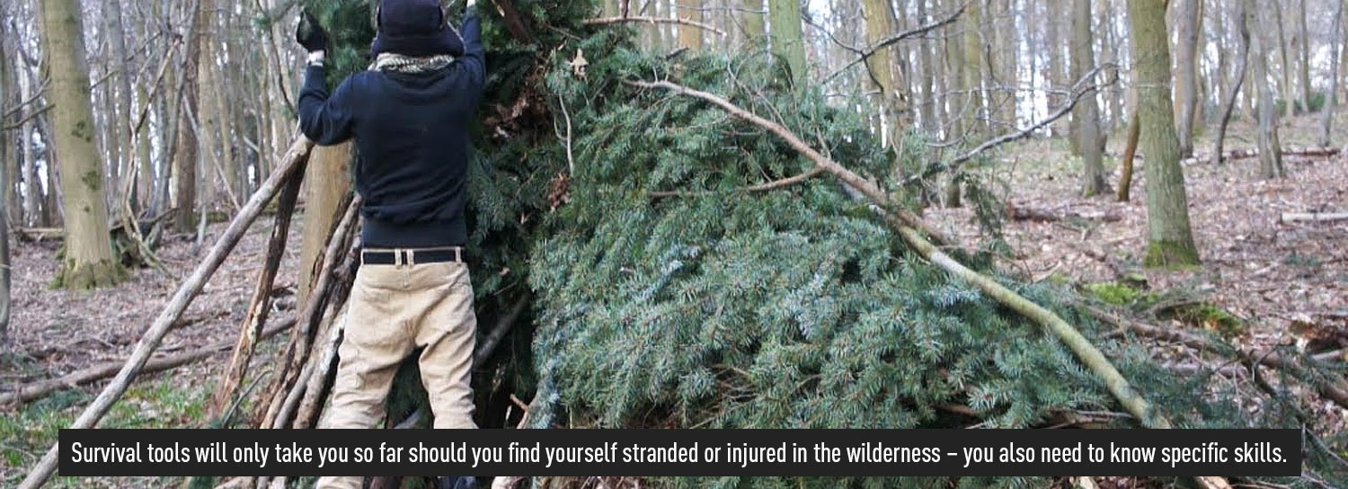Man Building a shelter in the woods