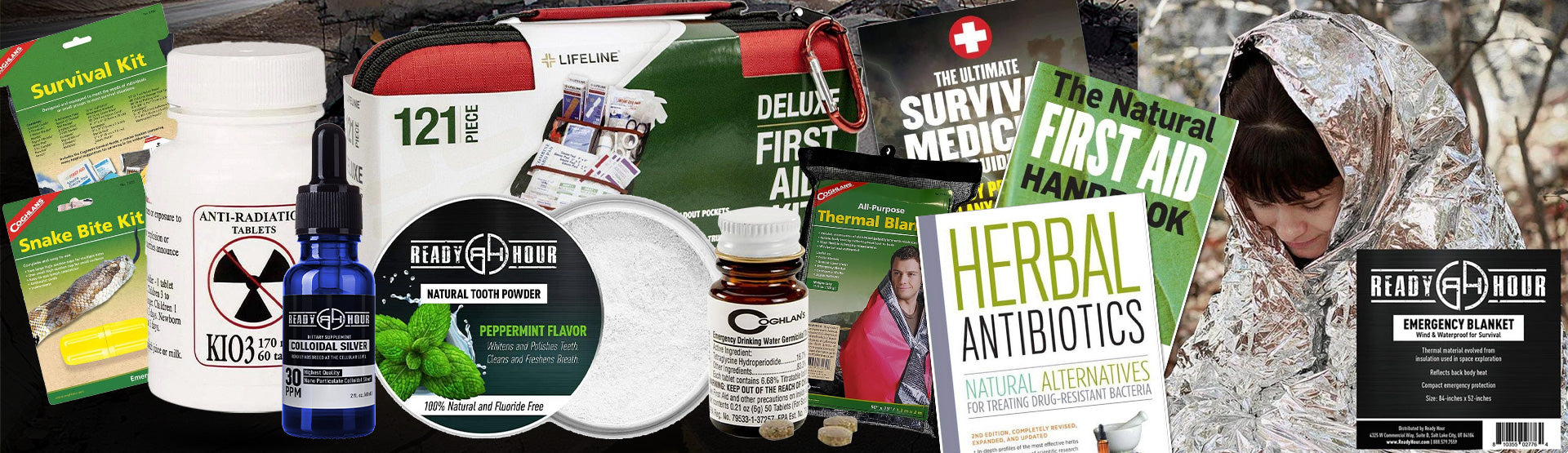 an assortment of first aid and medical supplies, books, medicines, thermal blanket, etc.