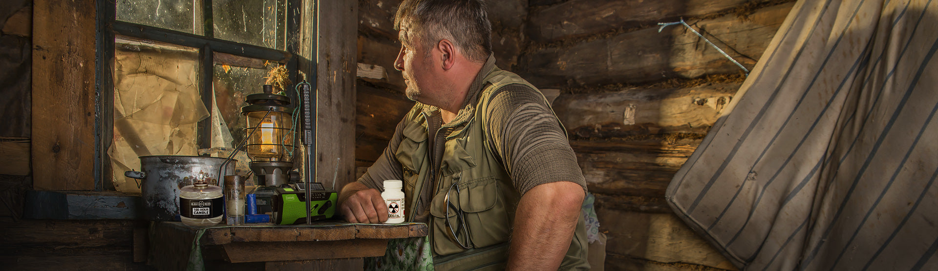 Survival Essentials - a man looks out his window with preparedness in mind.