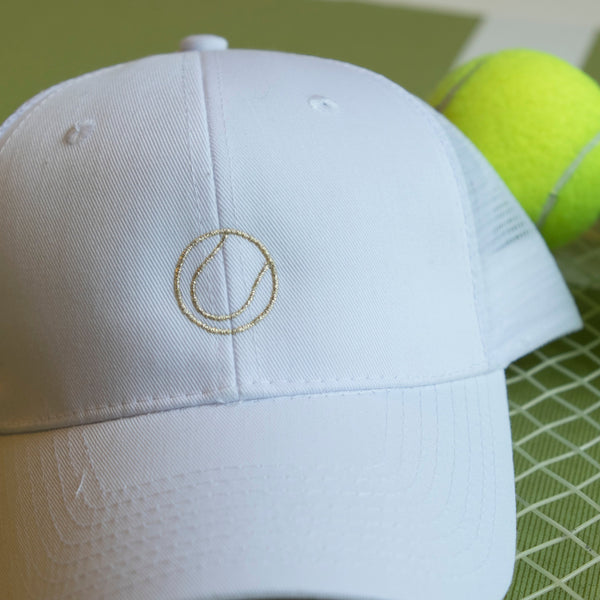 Women's trucker hat with gold tennis ball
