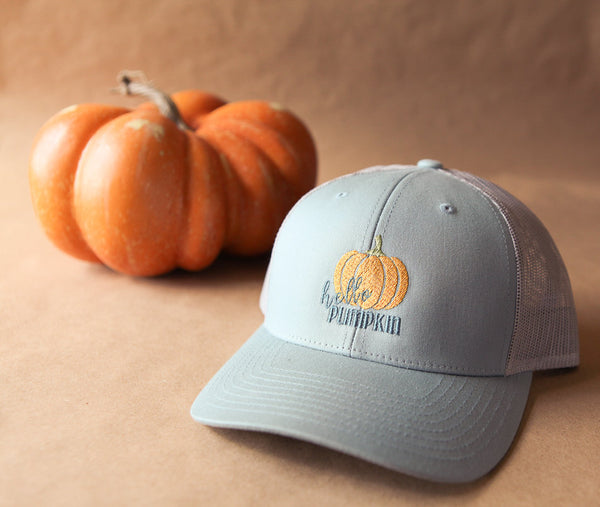 Fall trucker hat with embroidered hello pumpkin