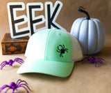Halloween trucker hat with embroidered spider
