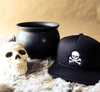 Toddler/kids/youth halloween trucker hat with embroidered skull and crossbones