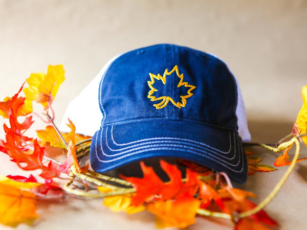 Fall trucker hat with embroidered leaf