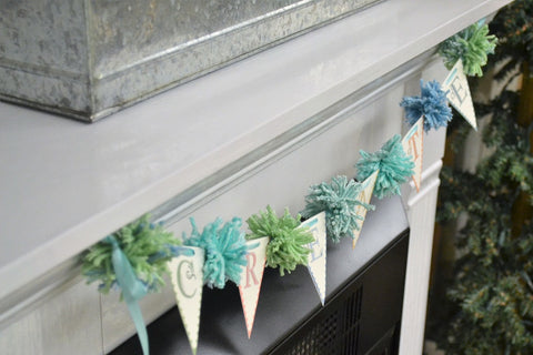 Photo of White Mantle with Pennant and Pom Pom Bunting