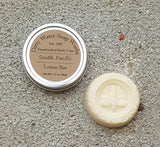 Travel lotion bar shown with keeper tin