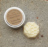 Bedside lotion bar shown with keeper tin