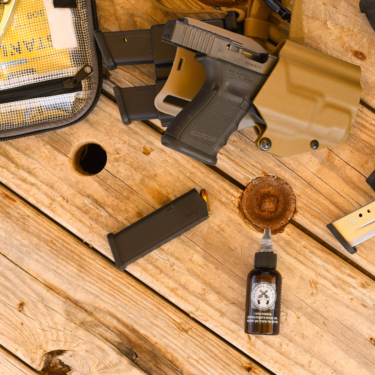 Bottle of Original Gun Oil with Every Day Carry Holster and Hand Gun