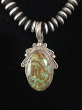Vintage small hook Nevada green pendant.