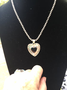 """The black onyx double heart"""