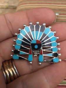 """The small head dress pen/ pendant"