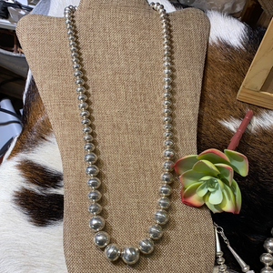 Totally tooled sterling silver bead necklace