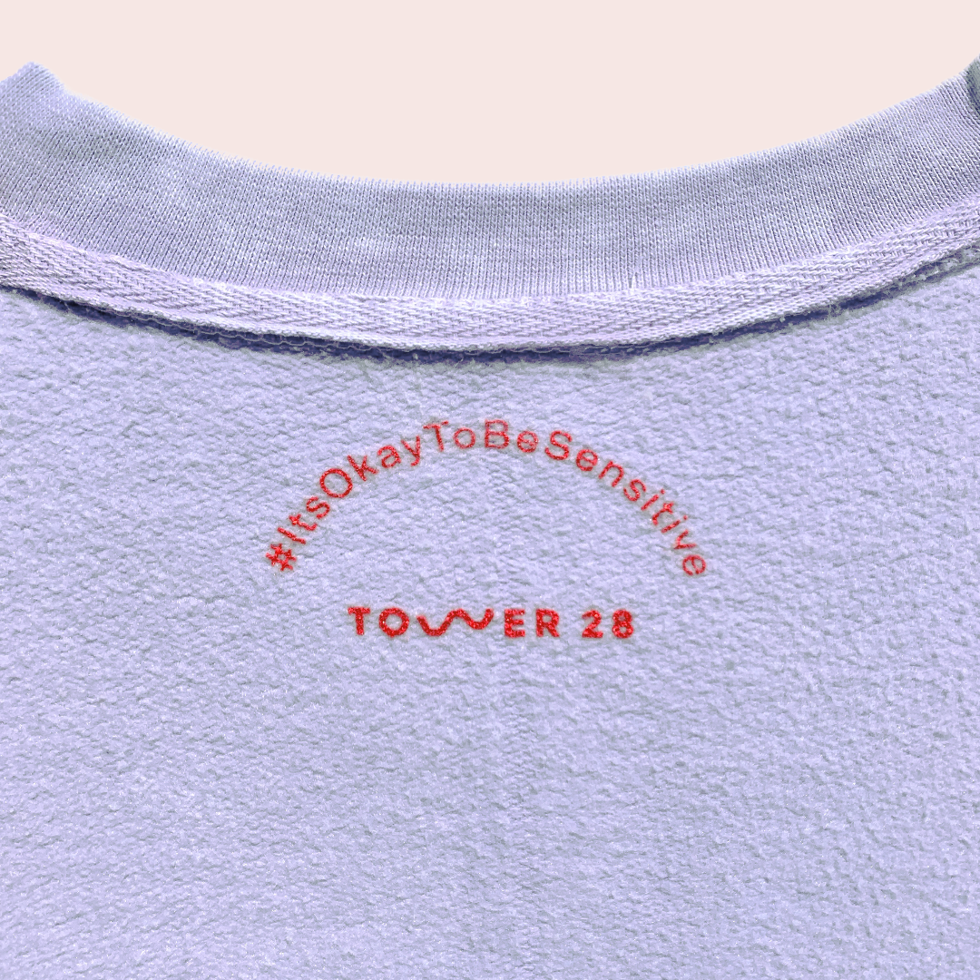 Inner Tag of Crewneck Sweatshirt by Tower 28 Beauty