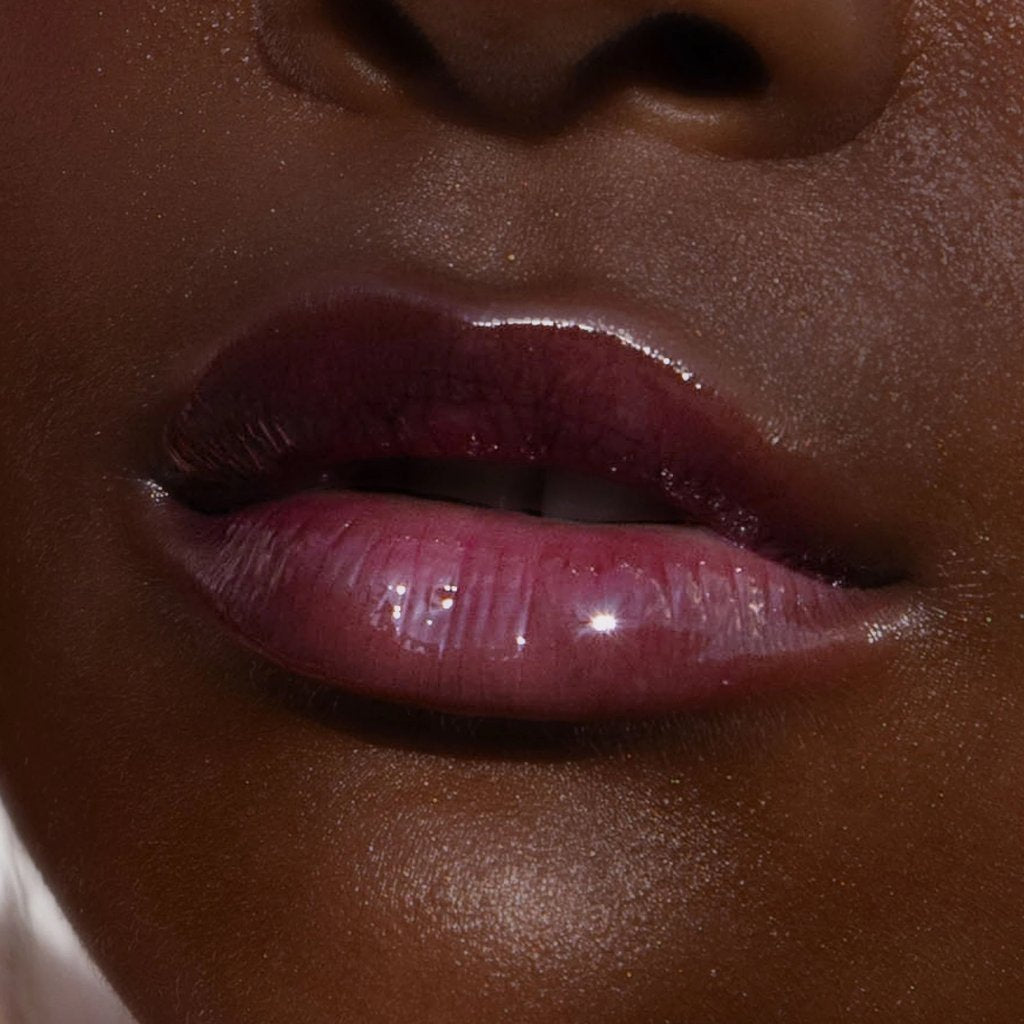 ShineOn Lip Jelly by Tower 28 Beauty - closeup lip swatch of shade Fear Less (a sheer berry gloss)