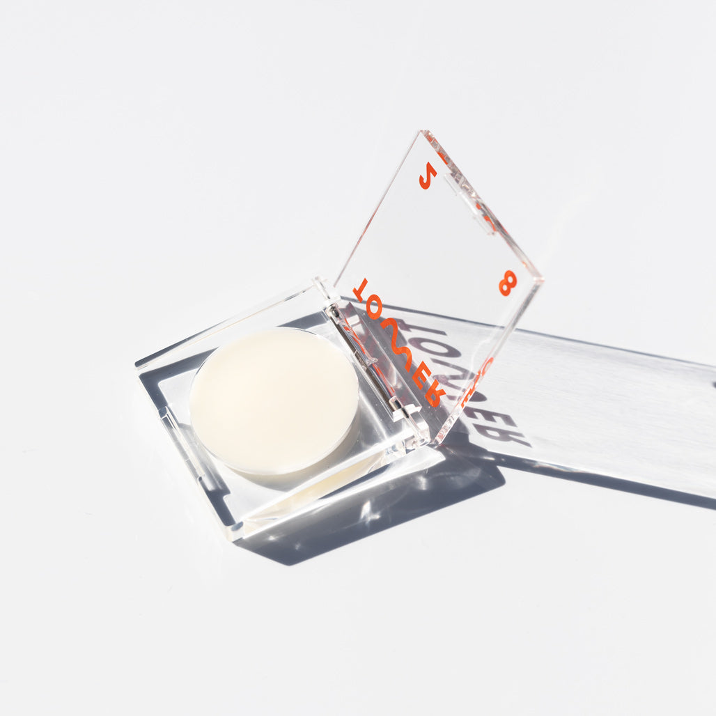SuperDew Shimmer-Free Highlight Balm in Clear Acrylic Packaging by Tower28 Beauty - In Clear Square Compact Packaging - National Eczema Association's Seal of Approval