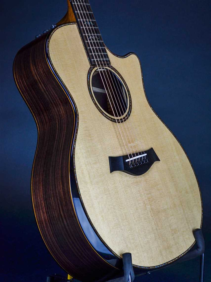Taylor 914ce V-Class Acoustic Guitar w/ Hard Shell Case Shape: Grand Auditorium Top Wood: Sitka Spruce Body Wood: Indian Rosewood Cutaway: Venetian Cutaway Bracing: V-Class Bracing