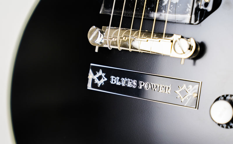 "Epiphone Jared James Nichols ""Old Glory"" Les Paul Custom Outfit - Black Aged Gloss  The Blues Power of Jared James Nichols' ""Old Glory"" Les Paul Custom The Jared James Nichols ""Old Glory"" Les Paul Custom Outfit is the premier signature model by the rising star from Les Paul's hometown."