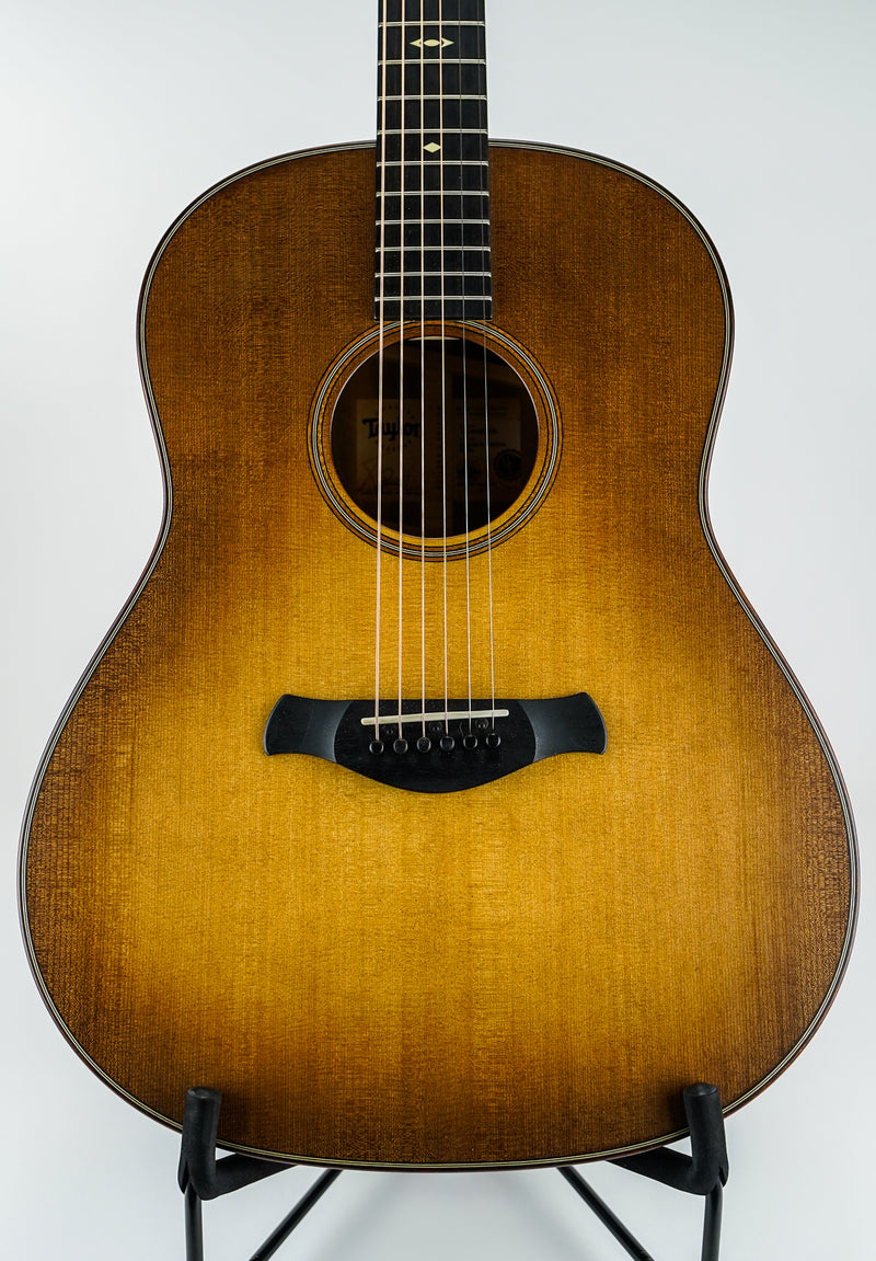 Taylor 517e Builder's Edition Wild Honey Burst V-Class Acoustic Guitar w/ Hard Shell Case  Shapes: Grand Pacific Top Woods: Sitka Spruce Body Woods: Tropical Mahogany Electronics: Expression System® 2 Cutaways: Non-cutaway Bracing: V-Class Bracing