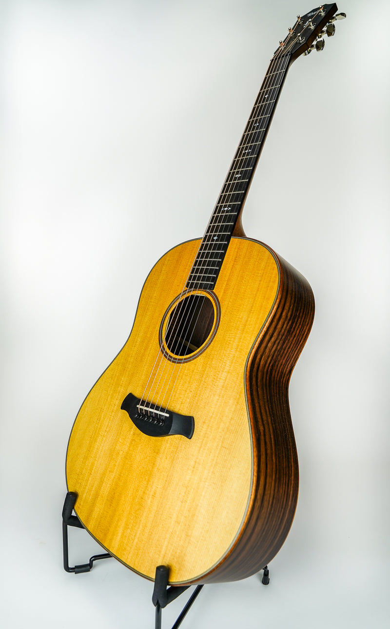 Taylor 717e Builder's Edition V-Class Acoustic Guitar w/ Hard Shell Case  Shapes: Grand Pacific Top Woods: Sitka Spruce Body Woods: Indian Rosewood Electronics: Expression System® 2 Cutaways: Non-cutaway Bracing: V-Class Bracing