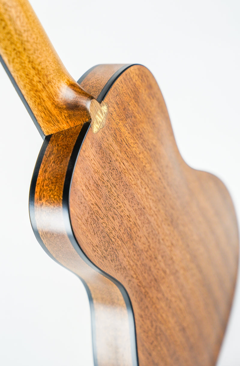 KALA SOLID SPRUCE TRAVEL CONCERT KA-SSTU-C  The ultra-thin Travel line is built to go anywhere. The thinbody makes these light and portable—perfect for any adventure. The arched back is designed to deliver a huge sound.  SPECS SIZE: Concert TOP: Solid Spruce BACK & SIDES: Mahogany