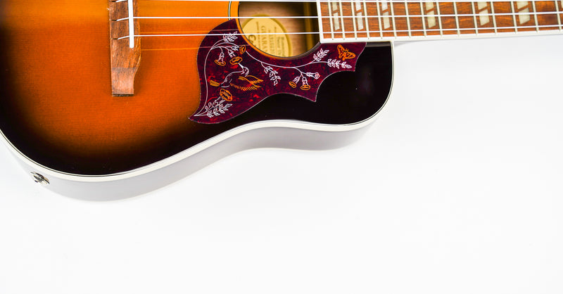 Epiphone Hummingbird Tenor Ukulele Tobacco Sunburst   Classic Hummingbird styling in a well-crafted, fun tenor uke! The Hummingbird Tenor Acoustic/Electric Ukulele (tuned GCEA) is Epiphone first tenor Uke in over half a century and features the iconic 'Hummingbird' pickguard, acoustic guitar body style with a Solid Sitka Spruce Top plus a Piezo under-saddle pickup so you can play anywhere! Gig bag included.
