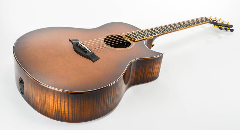 Taylor Grand Orchestra Custom Acoustic Guitar Back/Side: Maple, A Flame (Highly Flamed) Back: 2-PC .200 backstrip Top: Sitka Spruce Fretboard/Bridge: Ebony Wedge: Same as Wood Binding Neck: Maple Peghead Veneer: Custom (Flamed Maple with burst to match back and sides) Bracing: Sitka Performance Bracing (Right Handed)