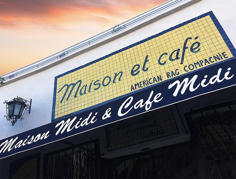 maison midi outdoor sign