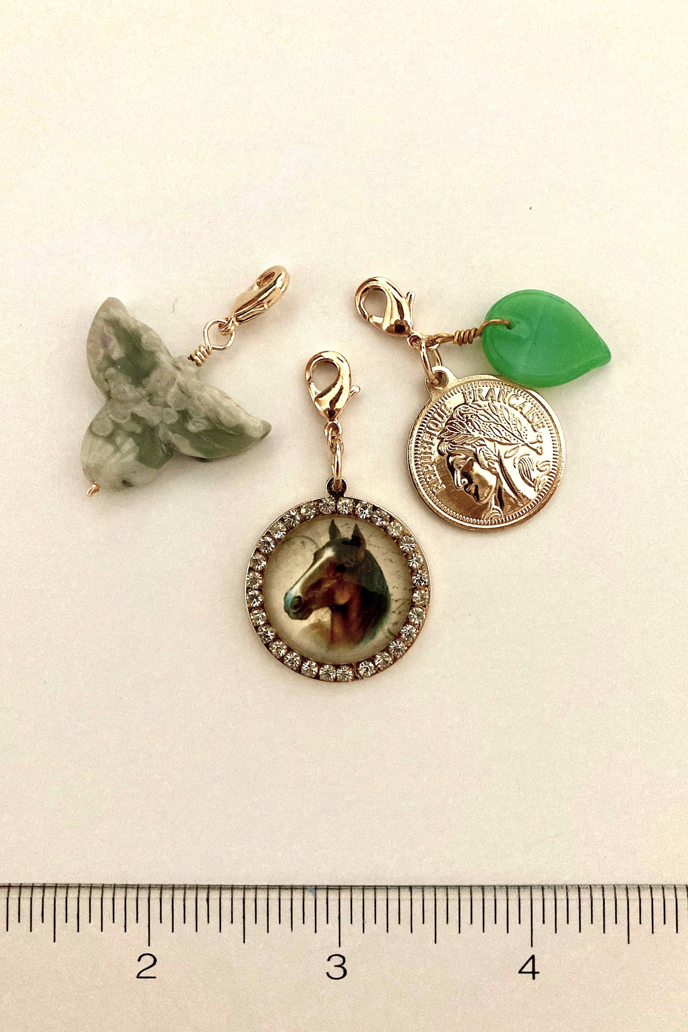 horse charm, coin charm and semi precious leaf, charms for arabella and ella necklace in our Pop Renaissance Collection.