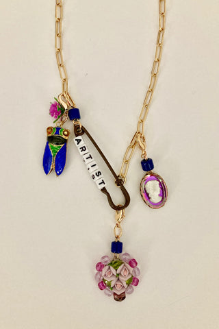 "charm necklace with ""artist"" word, cloisonne cicada, glass vitrail cameo and ceramic flowers."