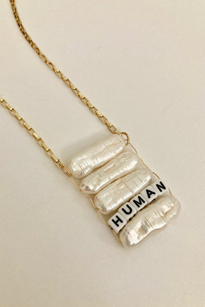 pearl necklace with Human word pendant