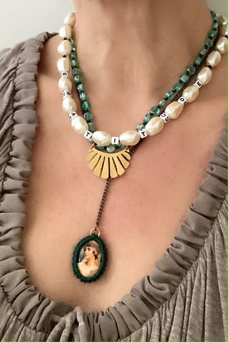 Baroque pearls with a bras fan charm on knotted green glass beads, cameo pendant. Pop Renaissance Collection.