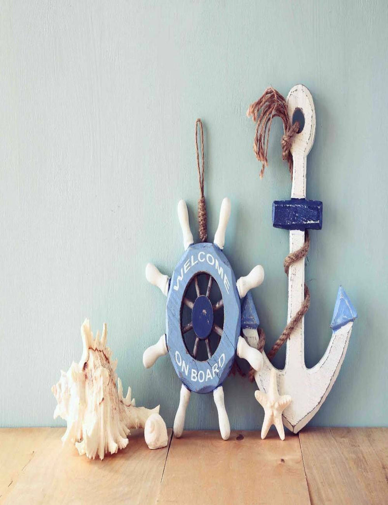 Solid Blue Background Anchor And Rudder On Wood Floor Backdrop
