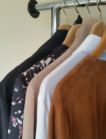 This is a shoulder / sleeve image showing 6 garments from our Curvy / Plus Size Collections hanging on a rack.