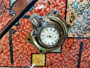 Vintage steampunk red travel box close up view of pocket watch detail