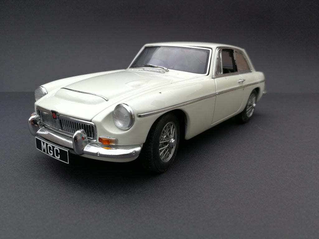 Auto Art MGC model car. Scale:1/18. Color: Cream and silver. 45 degree view.