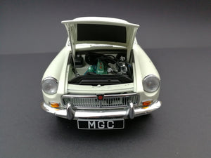 Auto Art MGC model car. Scale:1/18. Color: Cream and silver. View of engin.