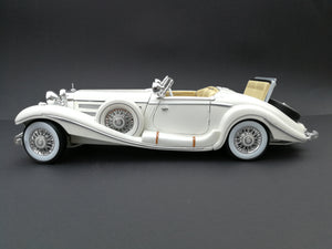 1936 Mercedez Benz 500K special roadster Diercast car. Scale: 1/18. White. Side view.