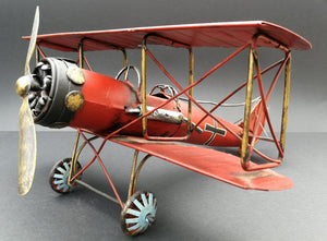 Tin aeroplane. Red and black. Hand made. 45 degree view.