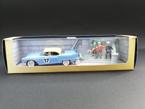 Crafted with care and detail, this Tintin diecast Cadillac Eldorado model depicts the rally car that wrecks the stairs leading to Haddock's estate on page 62 of The Red Sea Sharks, comes in box,  front view.