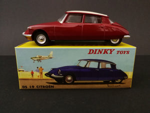 Dinky Toys 530 DS 19 Citroen model car, red, on top of box, side view.
