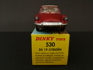 Dinky Toys 530 DS 19 Citroen model car, red, on top of box , front view.