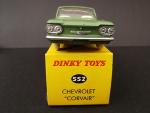 Dinky Toys 552 Chevrolet Corvair, green, on top of box, front view.