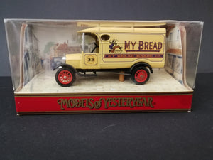 "Matchbox Models of Yesteryear Y21, 1926 Ford Model ""TT"", comes with box, color cream and red, side view"