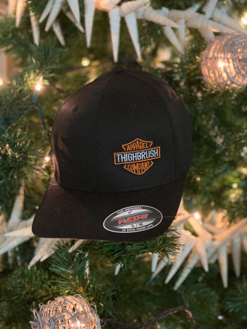 "THIGHBRUSH® BIKERS - ""THIGHBRUSH APPAREL COMPANY"" - FlexFit Hat in Black with THIGHBRUSH® Apparel Logo on the Left Front. Available in Sizes Small/Medium and Large/X-Large."