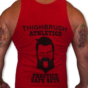 "THIGHBRUSH ATHLETICS ""Practice Safe Sets"" Men's Gym Tank. Red with Black Logo/Print, Available in Sizes S-XXL. Tultex Pre-Shrunk Fabric - 90% Cotton and 10% Polyester.  https://thighbrush.com/products/thighbrush-athletics-practice-safe-sets-mens-gym-tank-red-and-black"