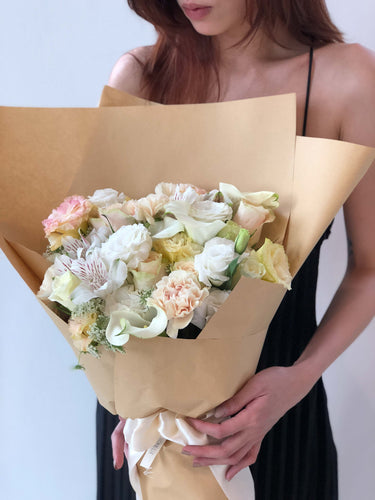 Fleuriste bouquet flowers utterly in love champagne roses calla lilies carnations rustic